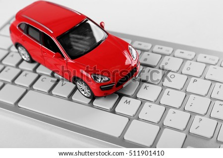Red toy car on a keyboard