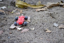 Red toy car on the ground