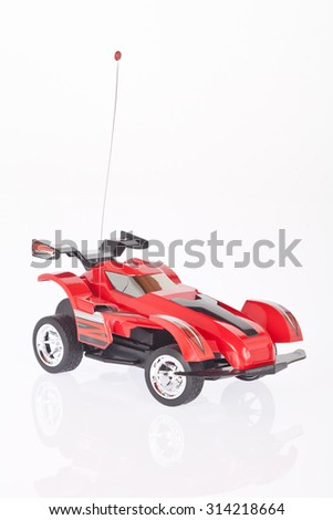 Red toy car on white background. Stock photo ©