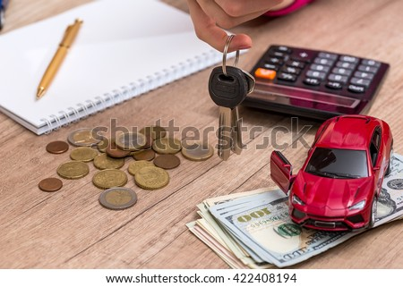 red toy car with money