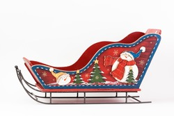 Red toy Christmas sleigh santa claus isolated on white background