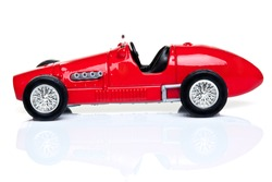 Red toy racing car isolated on a white background