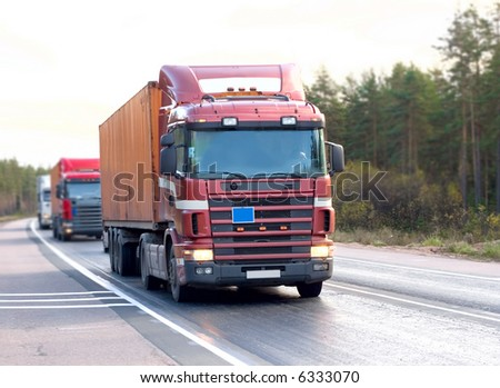"Red tractor trailer trucks caravan convoy line rides a country road. One of my ""Trucks"" portfolio series"