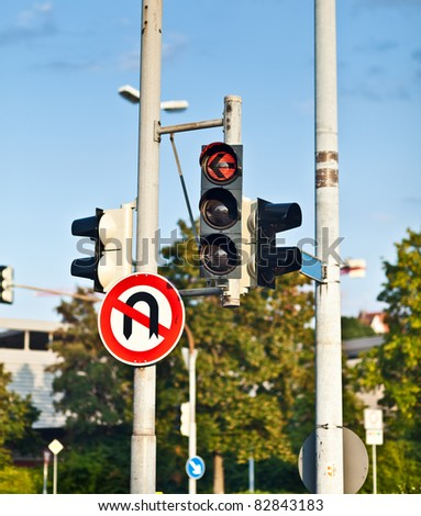 Red traffic light and do-not-turn sign