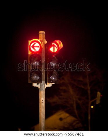 Red traffic light at night