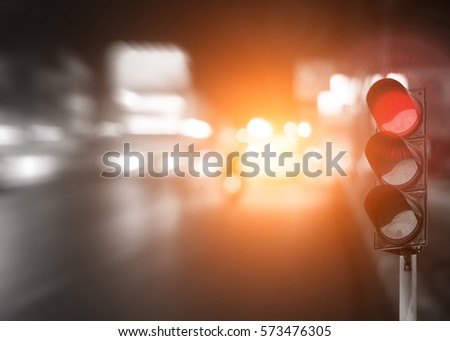 red traffic light on road in...