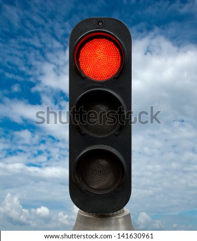 Red traffic lights against blue sky backgrounds. Clipping Path included.