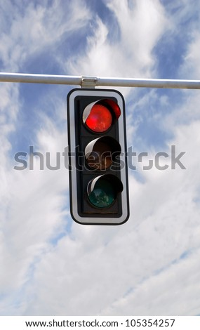 Red traffic lights against blue sky backgrounds with clipping path