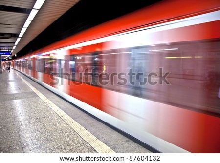 red Train arriving in the station