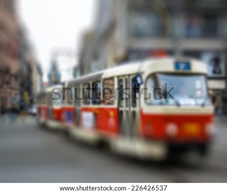 Red tram, intentional blurred background post production