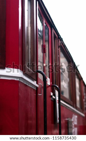 red tram, photo of a tram car, creative work, excellent background for a coffee house  #1158735430
