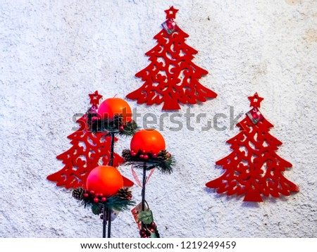 red trees, in 2d on a white wall, with colored candles for a Christmas atmosphere or a greeting card