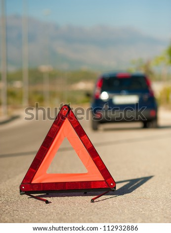 Red triangle on the road to signal a breakdown