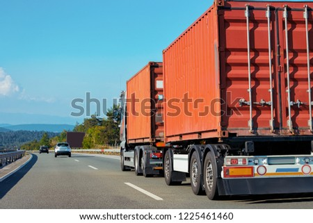 Red Truck at the alphalt road of Poland. Lorry transport delivering some freight cargo. #1225461460