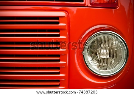 red truck grill and headlight with focus only on the light