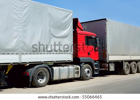 Red truck with cargo container in port
