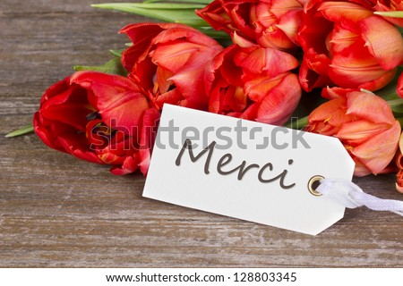 red tulips and label with lettering thanks/thanks/tulips