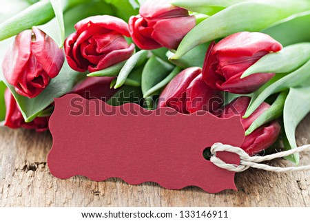 red tulips and tag with copy space