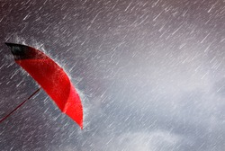 Red umbrella against the storm,sky background and black cloud group and rain, preventing rain and wind hazards,saving planning, and health care,thunderstorm with insurance concept, accident protection