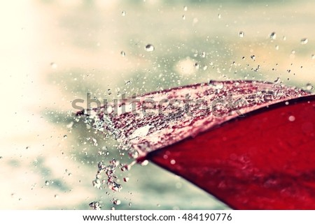 red umbrella and rain #484190776