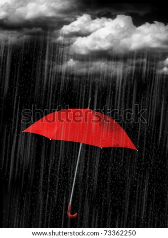 Red umbrella's in heavy rain to use as background