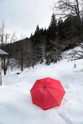 red umbrella snow photo