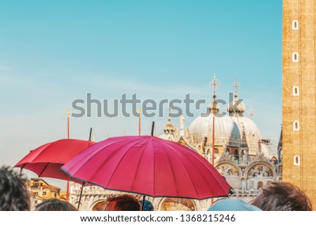 Red umbrellas of tour guides conducting tours on the background of the Piazza San Marco in Venice. Tourist destination. #1368215246