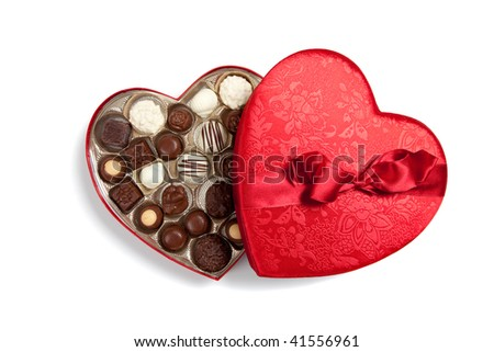 Red valentine heart filled with chocolates on a white background