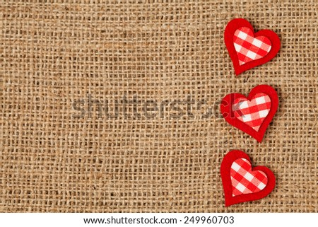 Red valentine\'s day holiday hearts  on retro textile background