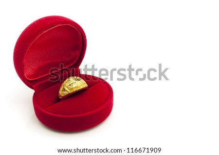 Red velvet box with golden ring