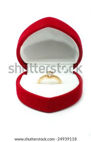 Red velvet box with golden ring