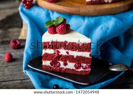 Red velvet cake on wood board. Slice of cake. Raspberry cake. Devil's cake. Wedding dessert. Birthday party. Delicious dessert. Traditional american dessert