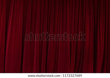 Red velvet curtain drapes