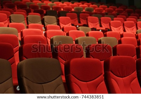 Red Velvet Fabric Cloth Empty Many Seats Row Column in Movie Theater Concert or Seminar Conference room #744383851