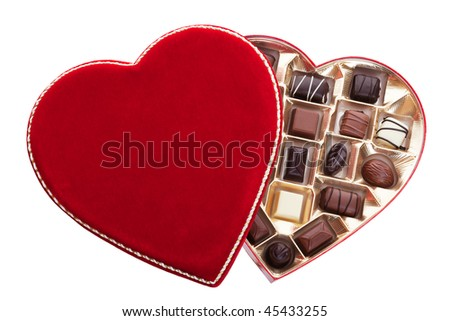 Red velvet, heart shaped box of chocolates.  Shot on white background.