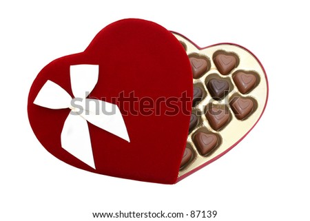 Red velvet heart shaped box with heart shaped chocolate truffles isolated  with a clipping path.