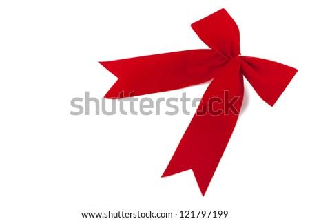 Red velvet ribbon in front of white background