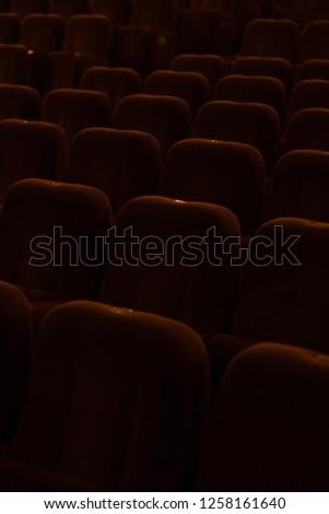 red velvet seats for spectators in the theater or cinema #1258161640