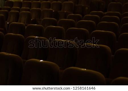 red velvet seats for spectators in the theater or cinema #1258161646