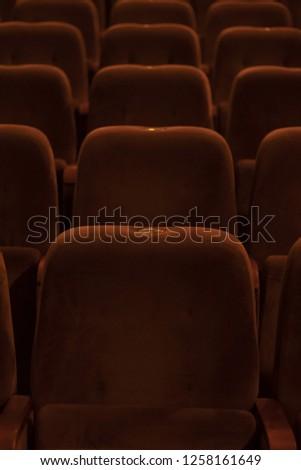 red velvet seats for spectators in the theater or cinema #1258161649
