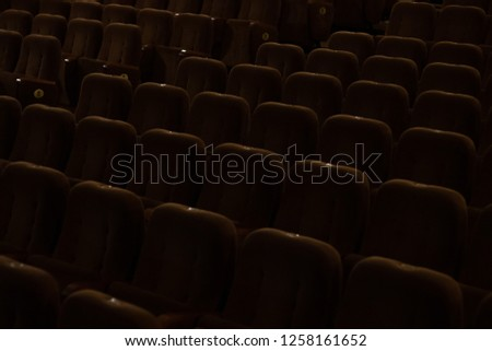 red velvet seats for spectators in the theater or cinema #1258161652