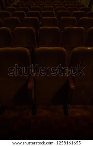 red velvet seats for spectators in the theater or cinema #1258161655