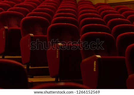 red velvet seats for spectators in the theater or cinema #1266152569