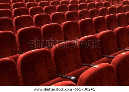 red velvet seats for spectators in the theater or cinema #665700241