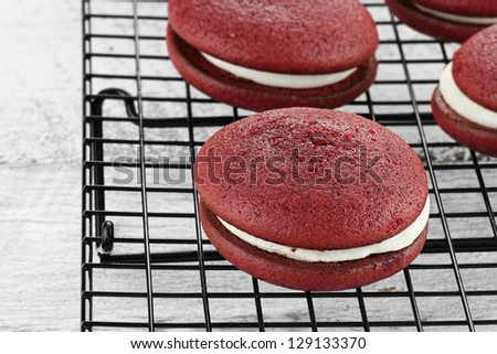 Red velvet whoopie pies or moon pies. Shallow depth of field.