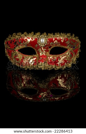 Red venetian carnival mask isolated on black background