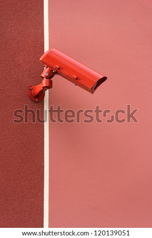 Red video Camera Security System on the wall