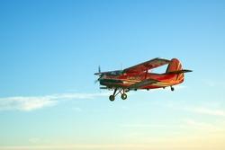 Red vintage airplane flying