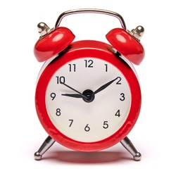 Red vintage alarm clock isolated on white background with clipping path