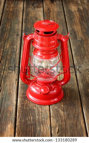 red vintage lamp on wooden table